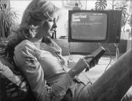 A woman tests the revolutionary new telephone-tv-linked communication system, with just one touch of a button you can get a wealth of information