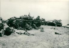 Soldiers around the tank.