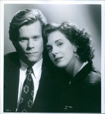 "A photo of Kevin Bacon and Elizabeth Perkins in a film ""He said, She said"" 1991"