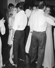 Carroll Baker hugging man.