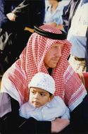Boris Becker in a kaffiyeh with Noah's son in Qatar