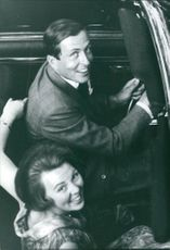 Beatrix and Claus of the Netherlands smiling in car.