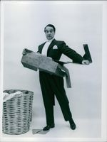 Danish comedian, conductor, and pianist Victor Borge is acting in a comedy show
