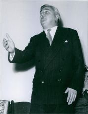 Low angle view of Aneurin Bevan talking to someone.