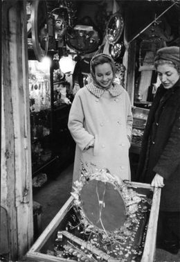 Leslie Caron in a antique shop.