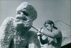 A photo of  a Canadian former actress Joanna Shimkus, Lady Poitier doing stone sculpture.