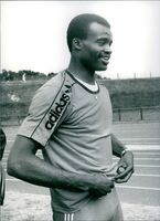 Kriss Acabusi photographed with a smile on his smile. 1985.