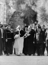 Pope Paul VI walking with people.