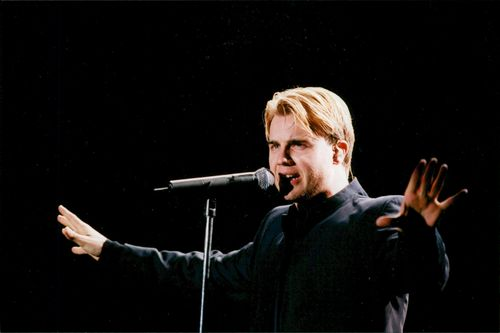 Gary Barlow appears on stage