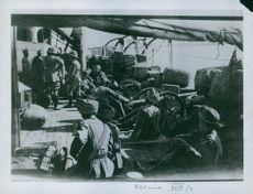 Soldiers sitting with their cannons in a ship, 1935.