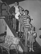 """Johan Jonatan """"Jussi"""" Björling standing on stairs with his family."""