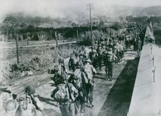 Allied move up in southern France. American troops moving up in southern France march past av eight-foot (2,4 meter) steel and concrete wall running the length of the beach.