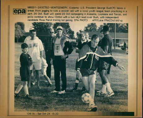 George Walker Bush with a local youth league.