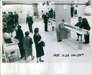 Weekend 24 November 1962 Hidden camera see attempted New York bank robbery. People in the bank, Man marked.