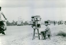 A child selling on the roadside.