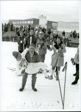 Toini Gustafsson is hoisted after taking gold at the women's 5 km during the 1968 Olympic Winter Games