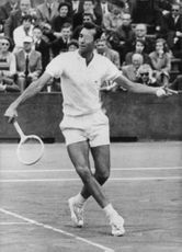 Andres Gimeno playing tennis.
