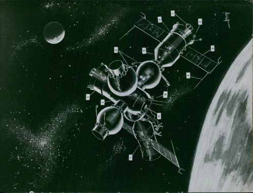 An illustration of space craft, planet and satellite.