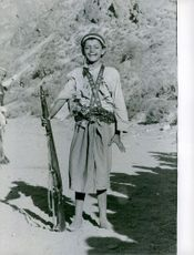 Boy holding a gun and laughing.