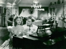 "The actors Grace Moore and Franchot Tone in the movie ""The King Steps Out"""