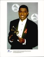 """Music producer Kenneth """"Babyface"""" Edmonds with his grammy"""