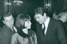 Actor Robert Hossein and actress Marie-France Pisier talking.  Taken - Apr. 1964
