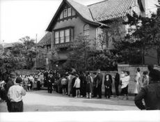 Japanese prince married (Prince AKihito and Michiko) People lining in queue to get inside of a house in Japan.