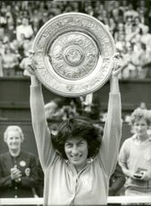 Virginia Wade holds up the championship trophy after the win in Wimbledon