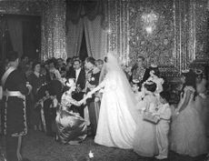 Woman curtsey before Farah Diba at her wedding to Mohammad Reza Pahlavi.