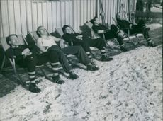 Men siting on the chair and relaxing outside.