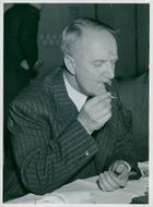 The government councilor Gunnar Hedlund, the center party leader, turns on a cigar