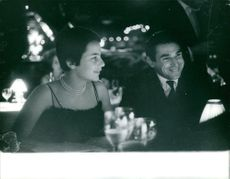 Robert Hossein with a woman, smiling.