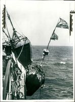 A mark buoy about to be hoisted aboard.