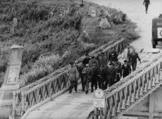 Military officials crossing a bridge in Israel.