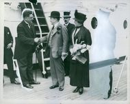 Stanley Baldwin hand shaking with a man in ship.