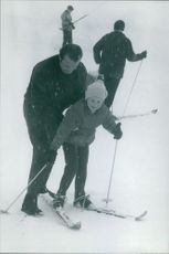 Albert II helping a child skiing. Photo taken Dec 30,1968