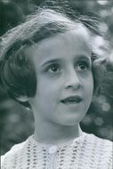 Portrait of a child, looking away.