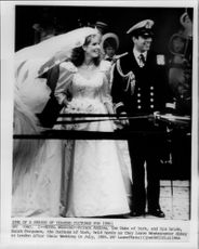 Prince Andrew and Sarah Ferguson hold hands together as they leave Westminster Abbey after the wedding.