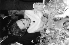 Wallis, Duchess of Windsor during a party on a dinner table.