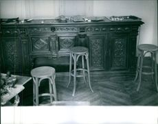 Old artistic wooden work and stools.