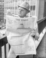 A man is reading the newspaper