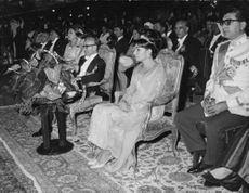 Mohammad Reza Shah Pahlavi and Farah Pahlavi among the audience.