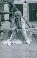 Marie France Anglade sitting and posing, surprised, 1967