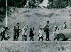 native prisoners of wars are guarded by soldiers. 1964.