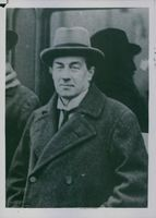 Stanley Baldwin looking towards the camera and smiling.