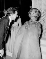 Danny La Rue as a woman at a charity event.