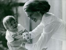 Princess Margaretha, playing with her child.