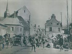 Soldiers in the street with their horses while carrying a chariot during First World War, 1936.