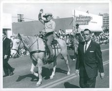 Barry Goldwater rides through the city