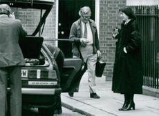 British politician, Geoffrey Howe, leaving Number Eleven Downing Street, his official residence in London, 1983.
